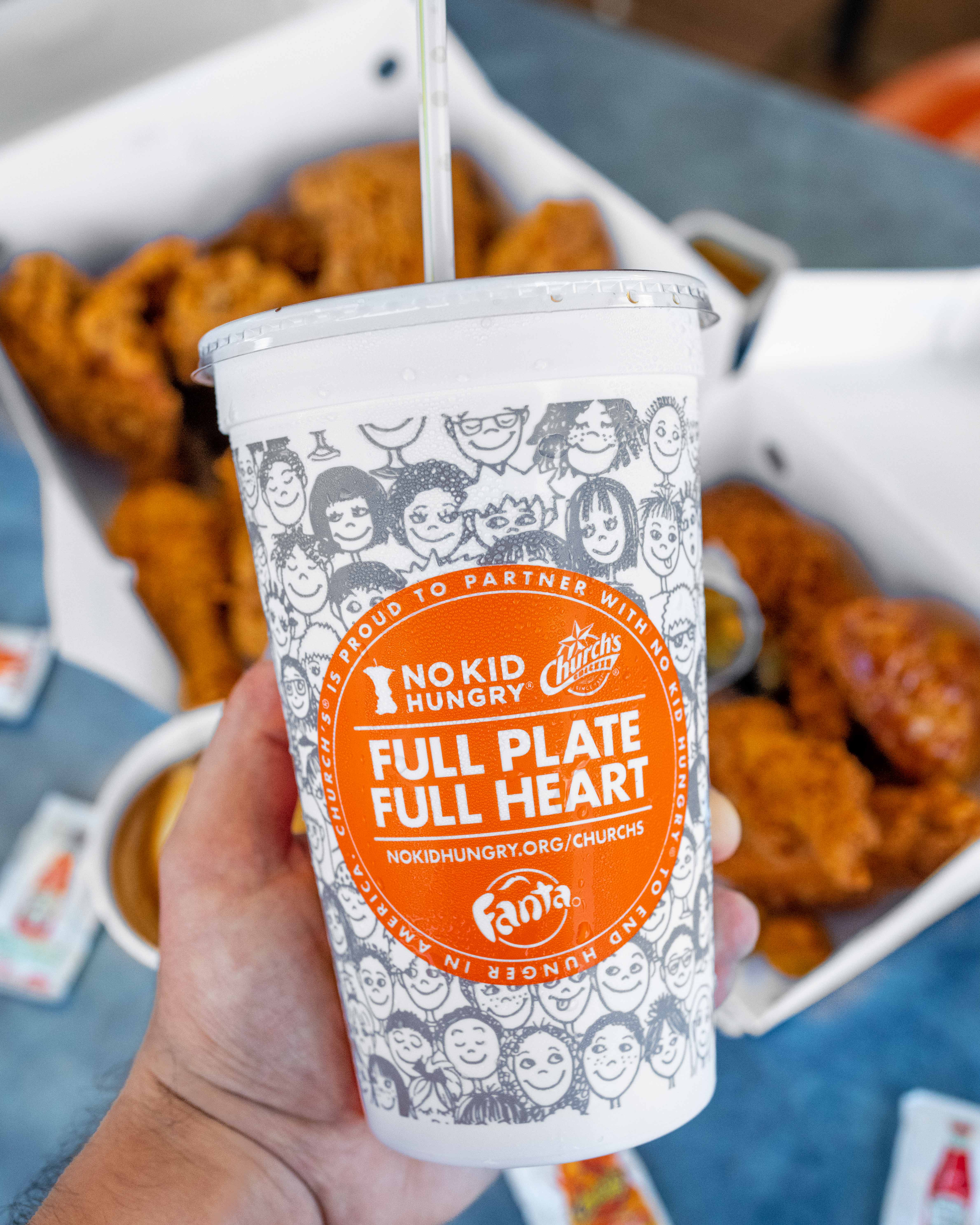 Church's Chicken #NoKidHungry Cup Held Over Chicken